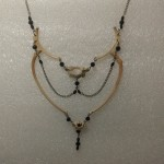 Ribs and vertebrae necklace-- Photo credit Poking Dead Things